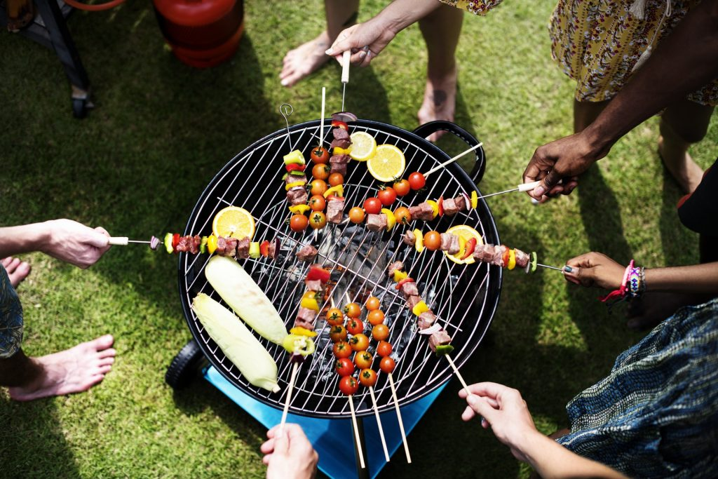skewers over a barbeque