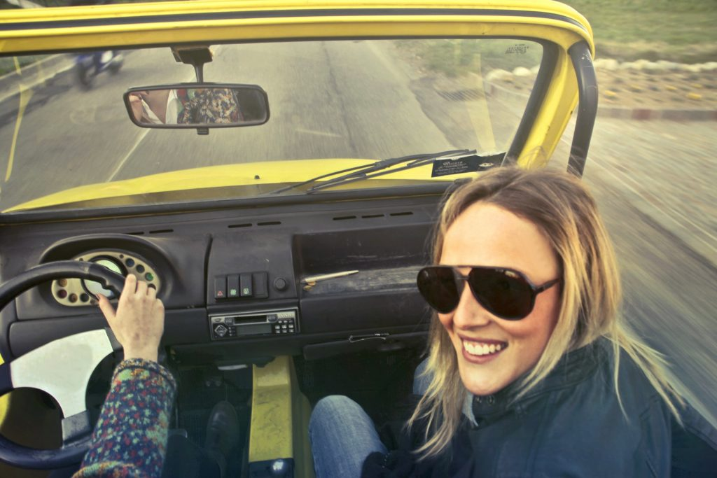 young people having fun in a car