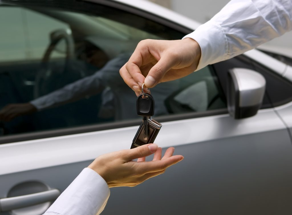 woman receiving car key from a man