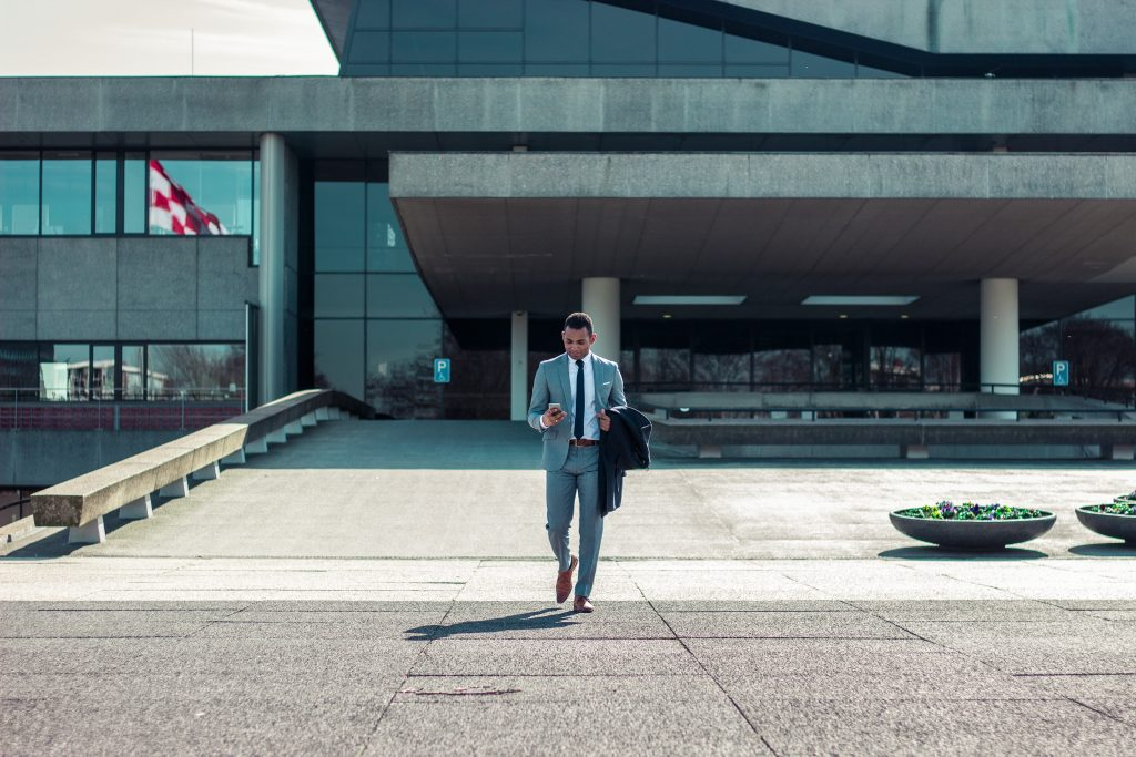 man in suit leaving building