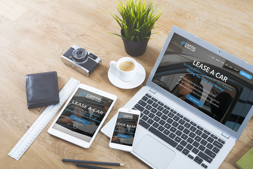 capital motor cars website on laptop and other devices
