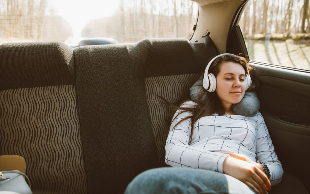 woman napping in car during road trip