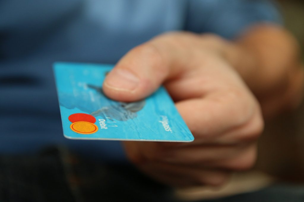 hand offering credit card