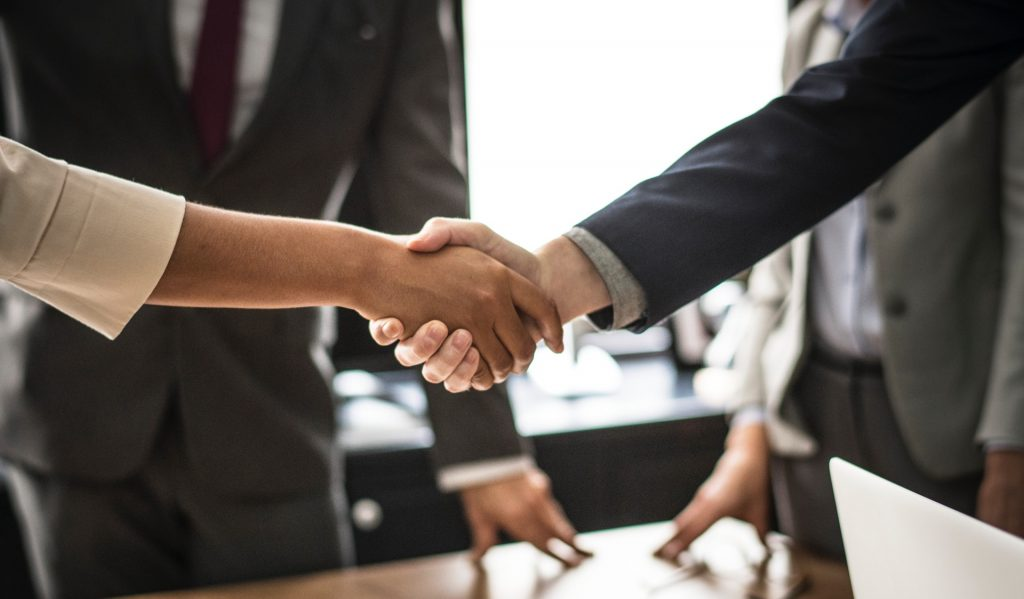 shaking hands over lease agreement